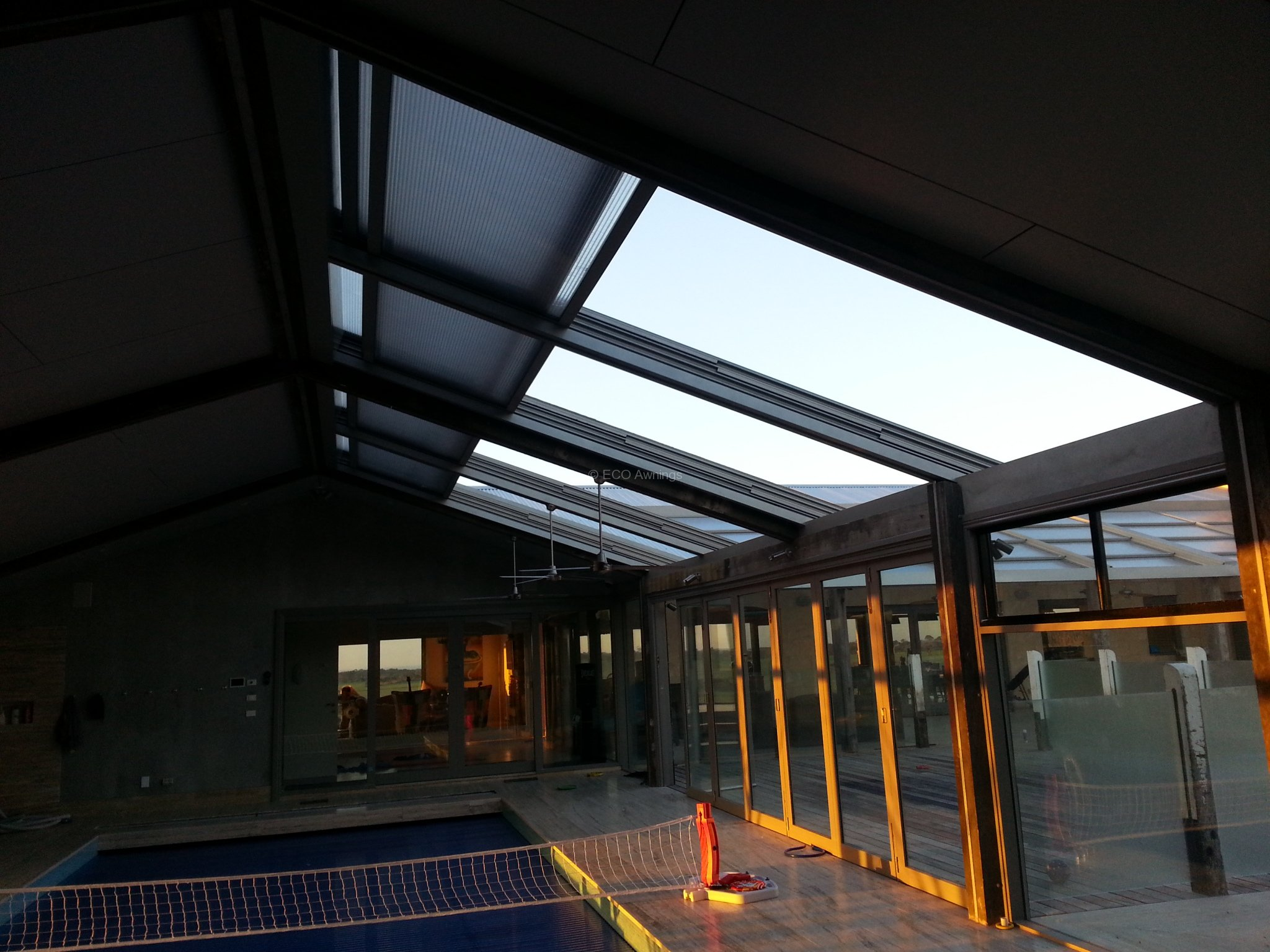 Retracta roof the sliding roof system 4bay 4panel above a for Indoor pool with retractable roof