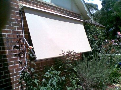 Pivot arm fabric awnings