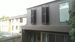 louvers that pivot off the wall